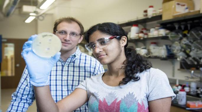 Neha Prasad and Prof. Tim Wencewicz in the research lab