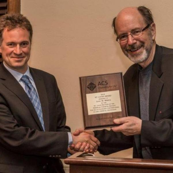 Professor Liviu Mirica receives the St. Louis Award from Professor Joseph Ackerman, Chair of the American Chemical Society St. Louis Section on October 15, 2016 at the St. Louis Award Banquet