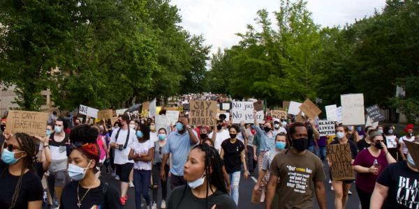People marching with signs at a Charlotte NAACP protest on June 8th, 2020. Photo by Leslie Cross on Unsplash.