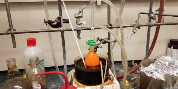 Orange reaction mixture in oil bath
