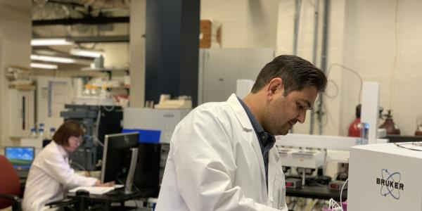 Two scientists use the mass spectrometry research resource in the Department of Chemistry